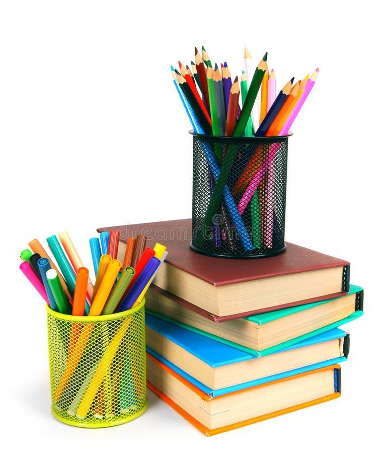 Libri e matite Su fondo bianco fotografie stock libere da diritti