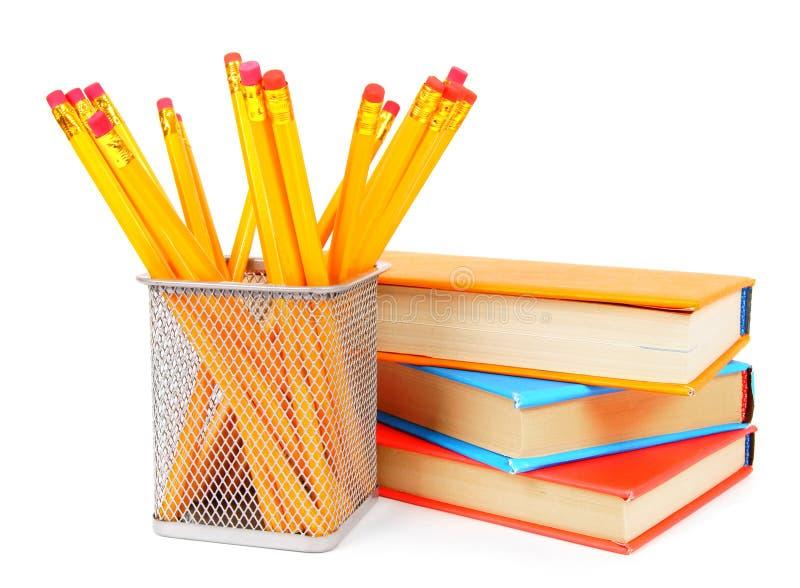 Libri e matite Su fondo bianco fotografia stock libera da diritti