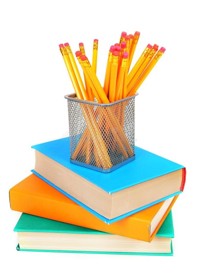 Libri e matite Su fondo bianco fotografia stock