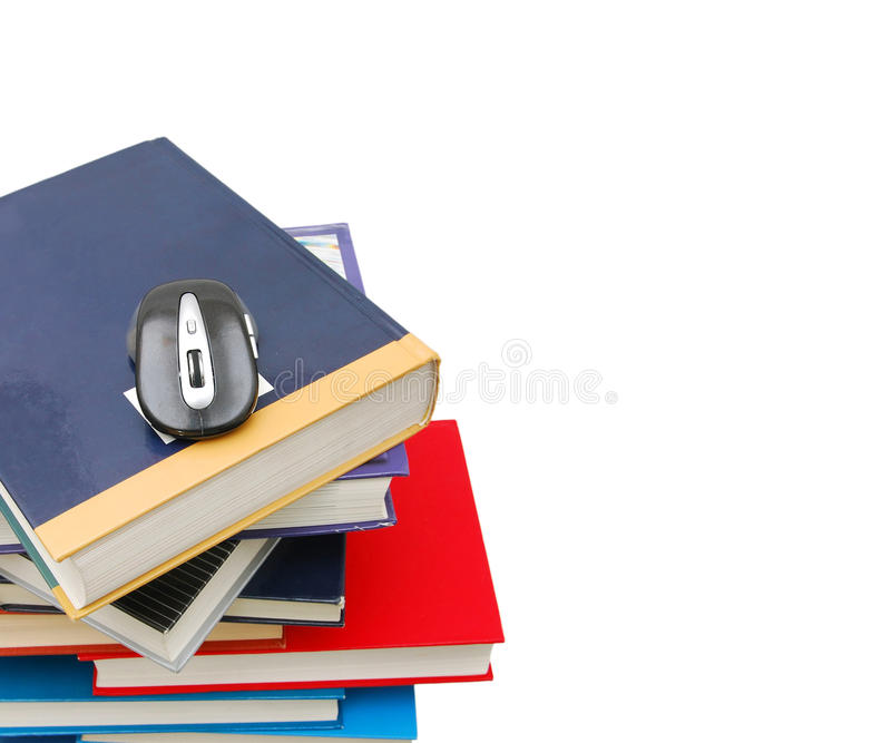 Libri e mouse del calcolatore fotografie stock libere da diritti