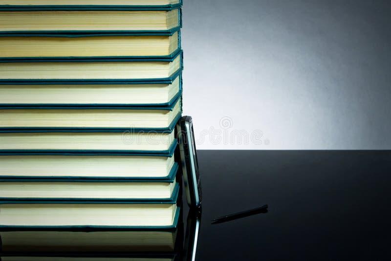 Libri e PDA immagine stock libera da diritti