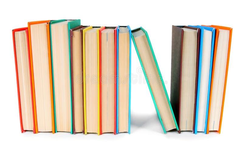 Libri Multi-coloured Su fondo bianco fotografia stock libera da diritti
