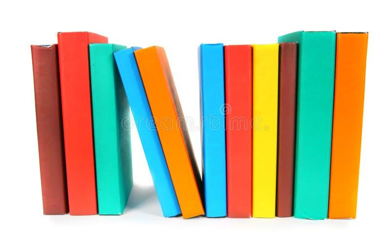 Libri Multi-coloured Su fondo bianco immagine stock libera da diritti