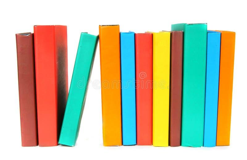 Libri Multi-coloured Su fondo bianco immagini stock