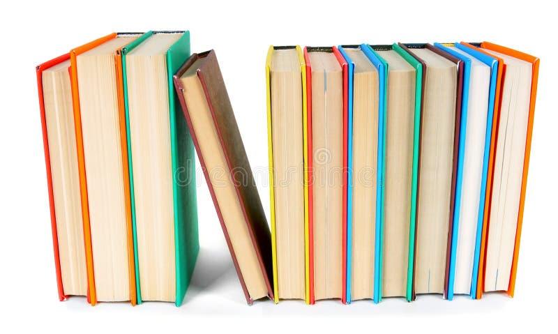 Libri Multi-coloured Su fondo bianco immagine stock