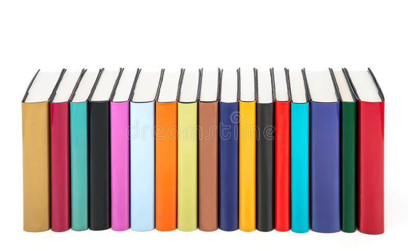 Libri variopinti in una fila fotografia stock libera da diritti