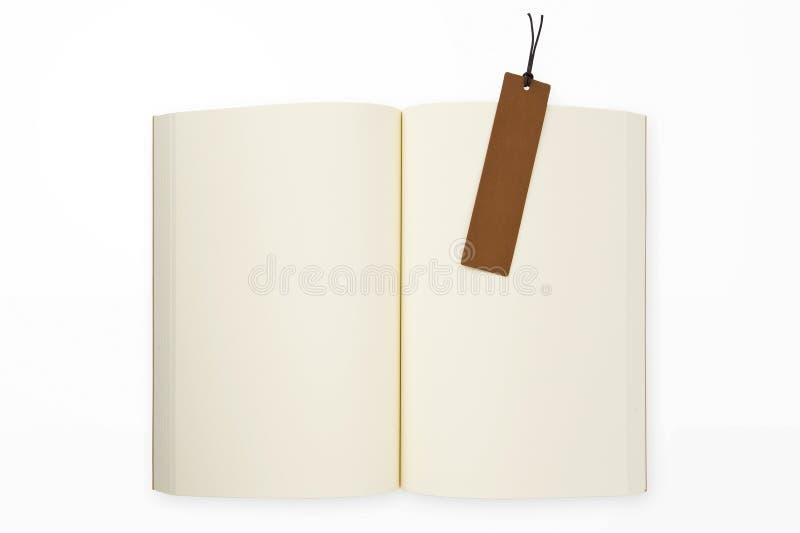 Libro aperto e segnalibro immagini stock