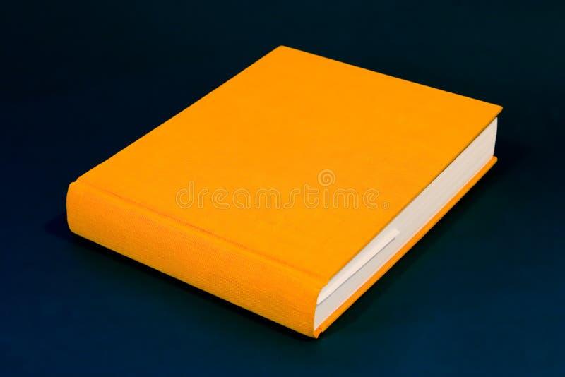 Libro arancione fotografia stock