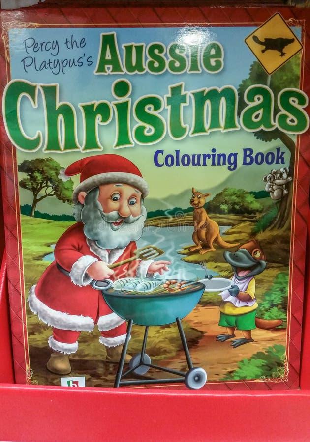 Libro australiano de colorantes navideños con Santa parrillada en la barbie a la venta en Australia fotografía de archivo