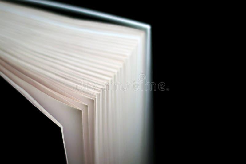 Libro con copertina rigida con bokeh Isolato sul nero fotografia stock