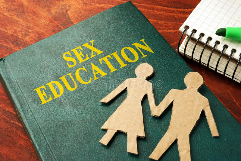 Libro con educazione sessuale di titolo fotografia stock libera da diritti