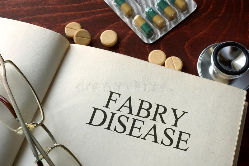 Libro con la enfermedad y las píldoras de Fabry de la diagnosis foto de archivo