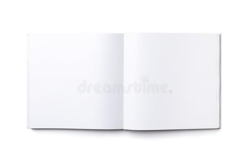 Libro cuadrado abierto en blanco aislado imágenes de archivo libres de regalías