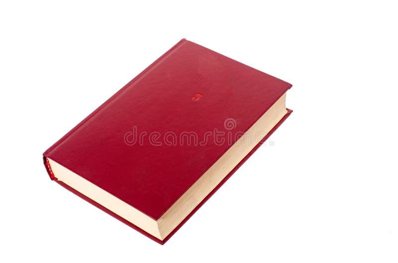 Libro de tapa dura rojo en blanco aislado en el fondo blanco con el espacio de la copia imagen de archivo