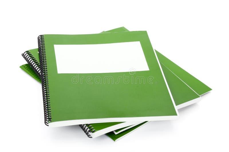 Libro de textos verde de la escuela fotografía de archivo
