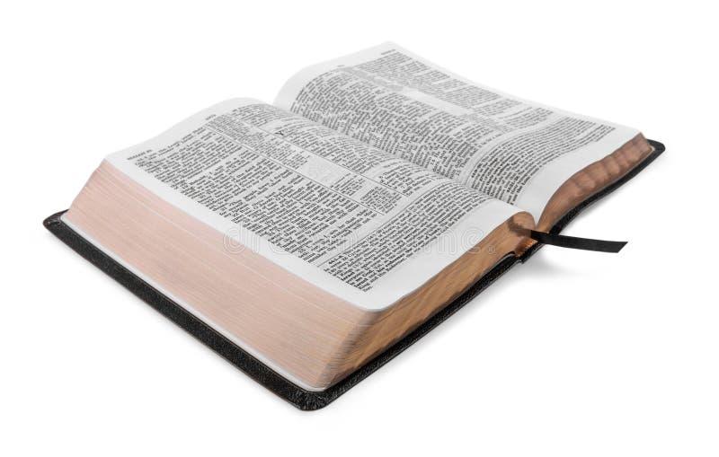 Libro della bibbia santa su un fondo di legno fotografia stock