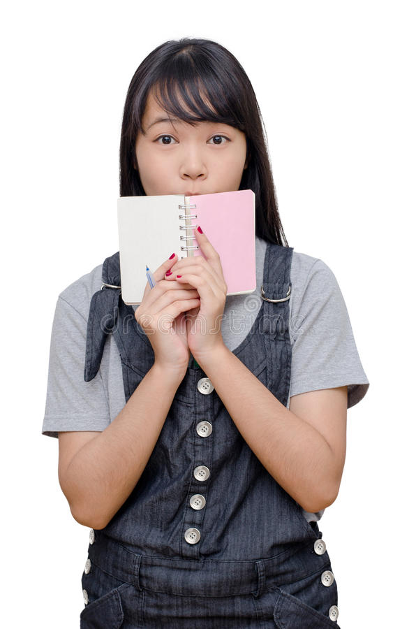 Libro di lettura della ragazza sopra bianco immagini stock