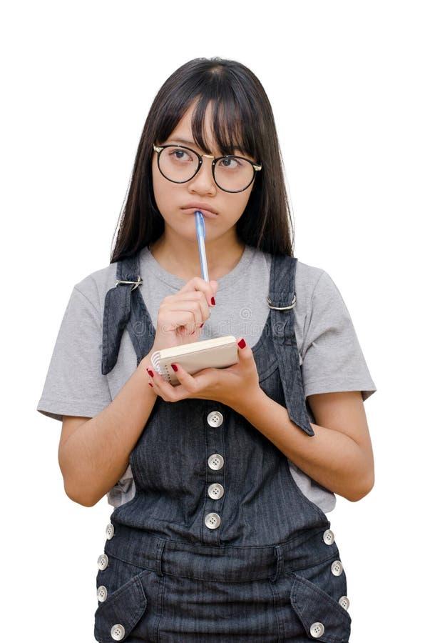 Libro di lettura della ragazza sopra bianco immagine stock