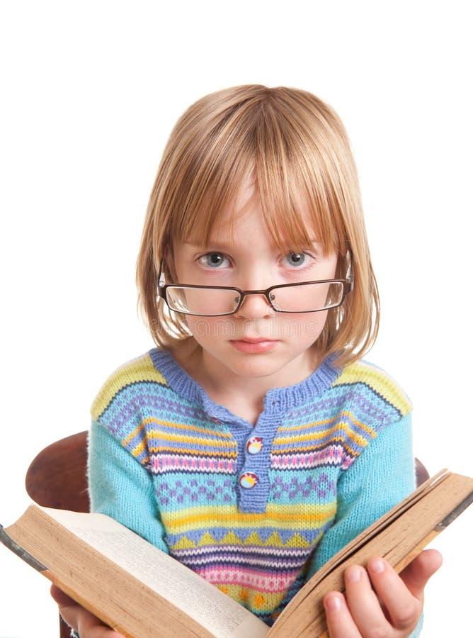 Libro di vetro del bambino isolato immagine stock