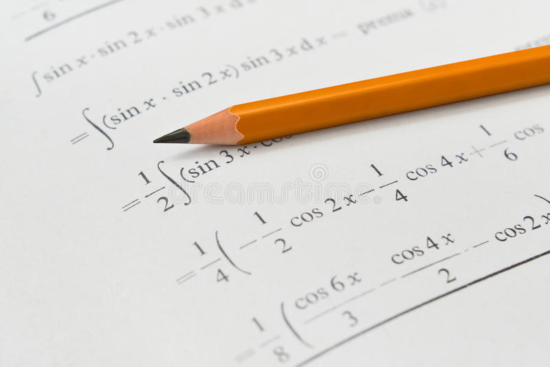 Libro e matita di per la matematica fotografie stock libere da diritti