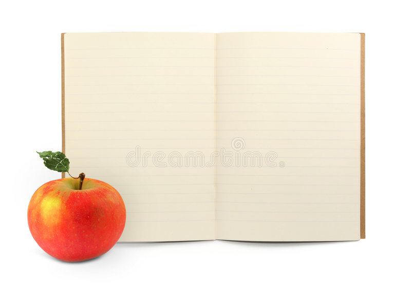Libro e mela di esercitazione immagini stock