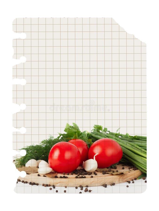 Libro en blanco viejo de la receta con la foto del tomate foto de archivo