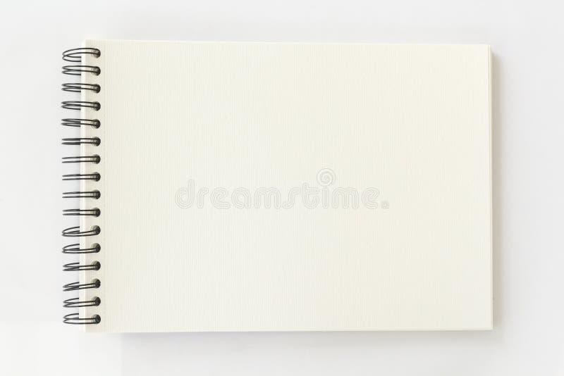 Libro espiral de la acuarela en el fondo blanco fotografía de archivo libre de regalías