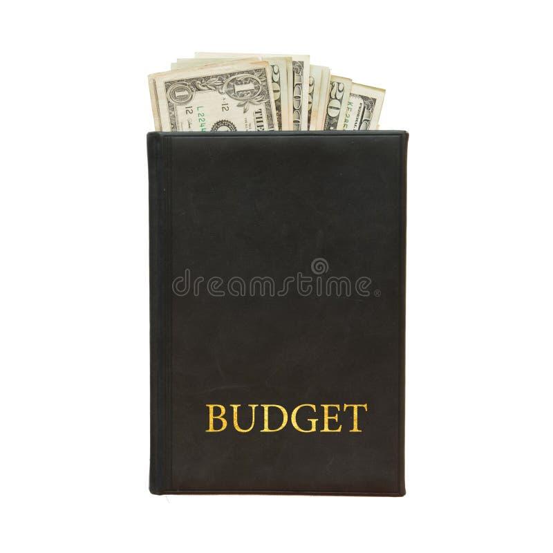 Libro nero con soldi ed il bilancio dell'iscrizione su fondo bianco fotografia stock