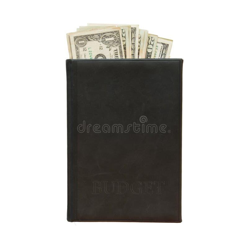 Libro nero con soldi ed il bilancio dell'iscrizione su fondo bianco immagine stock libera da diritti