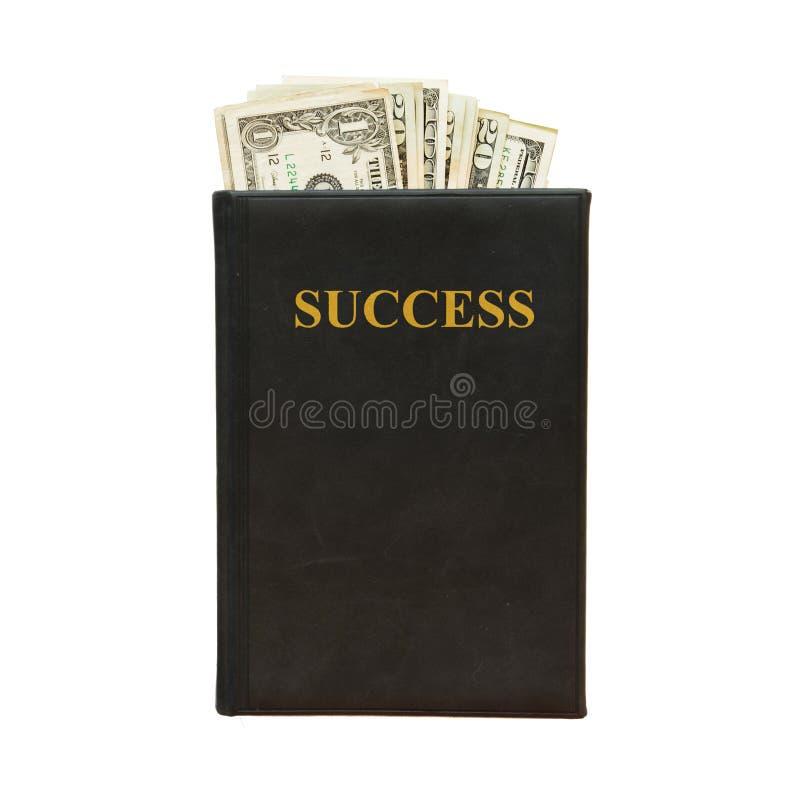 Libro nero e soldi con il successo dell'iscrizione su fondo bianco immagine stock