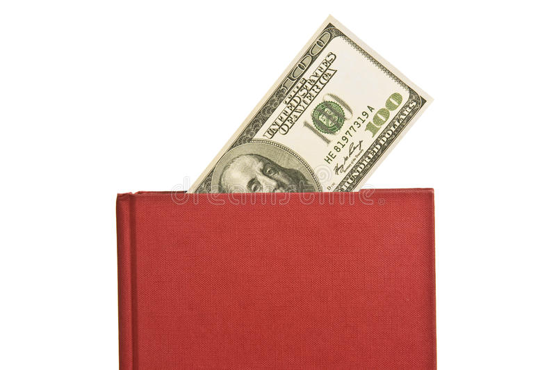 Libro rojo con la cubierta en blanco y cientos billetes de dólar fotos de archivo libres de regalías