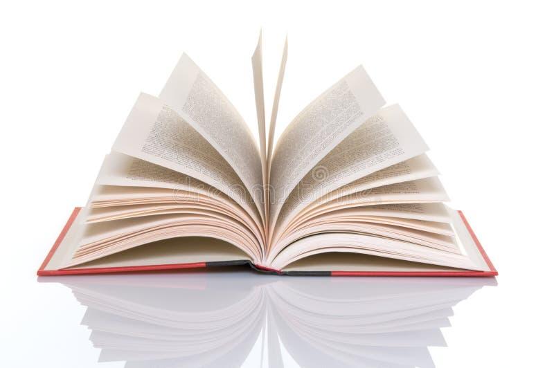 Libro rosso con le pagine aperte fotografie stock
