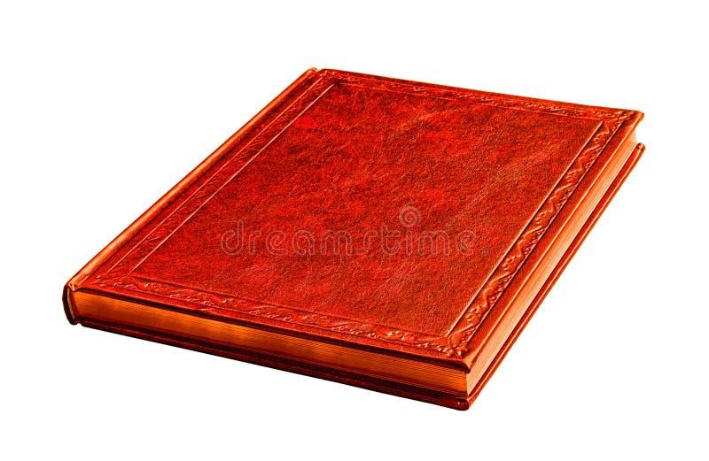 Libro rosso con le pagine dell'oro isolate su bianco fotografia stock