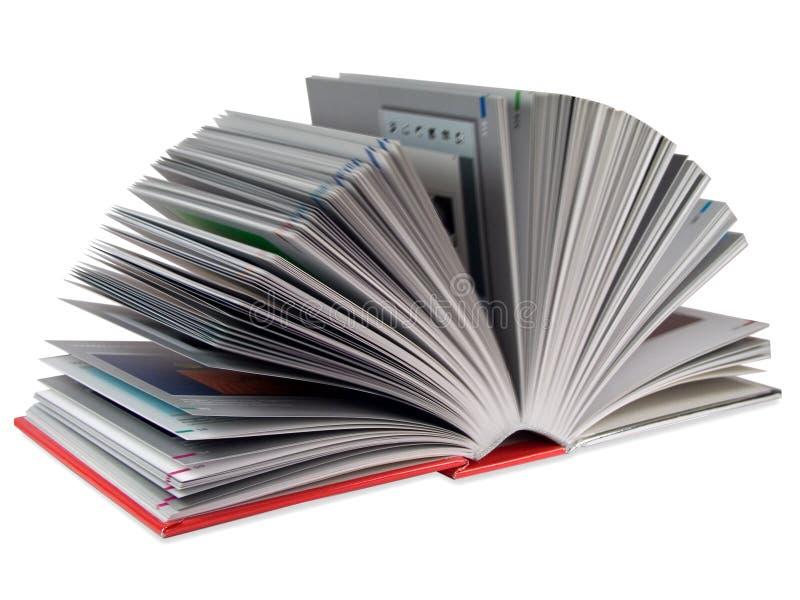 Libro rosso spalancato fotografia stock