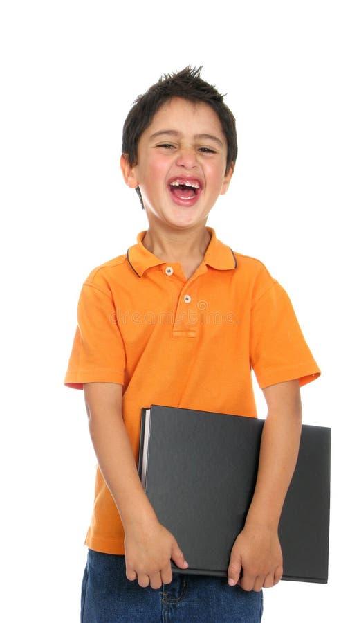 Libro sonriente feliz de la pizca de la muchacha imagenes de archivo