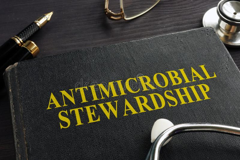 Libro sull'AMS antimicrobico di amministrazione fotografia stock libera da diritti