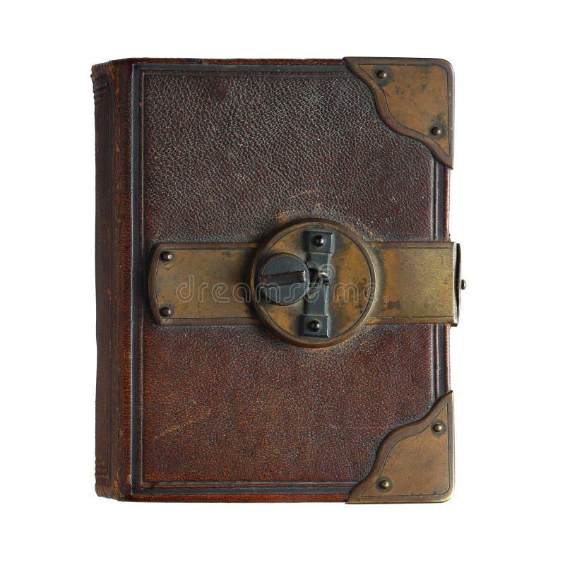 Libro viejo con la cerradura aislada en blanco imagenes de archivo