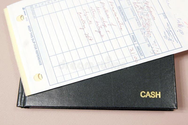 Libro Y Recibos De Caja Imagen de archivo