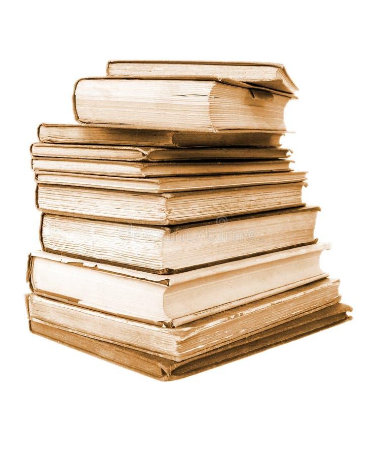 Libros anticuarios aislados estilo de la sepia fotos de archivo