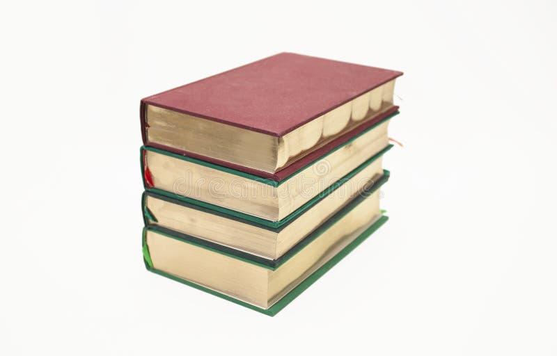 Libros antiguos con el corte del oro fotos de archivo