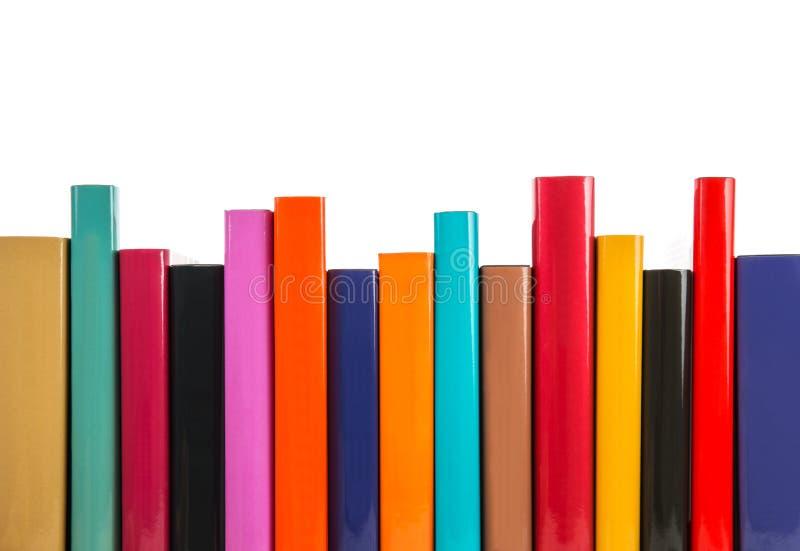Libros coloridos en fila imagen de archivo libre de regalías