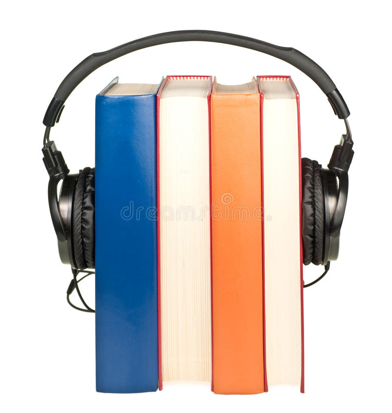 Libros con los auriculares foto de archivo