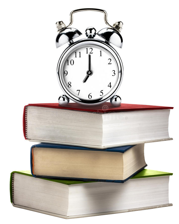 Libros del libro de la pila de la alarma del reloj del vintage coloreados aislados imágenes de archivo libres de regalías