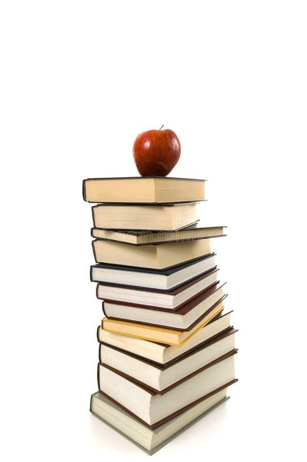 Libros y Apple imagenes de archivo