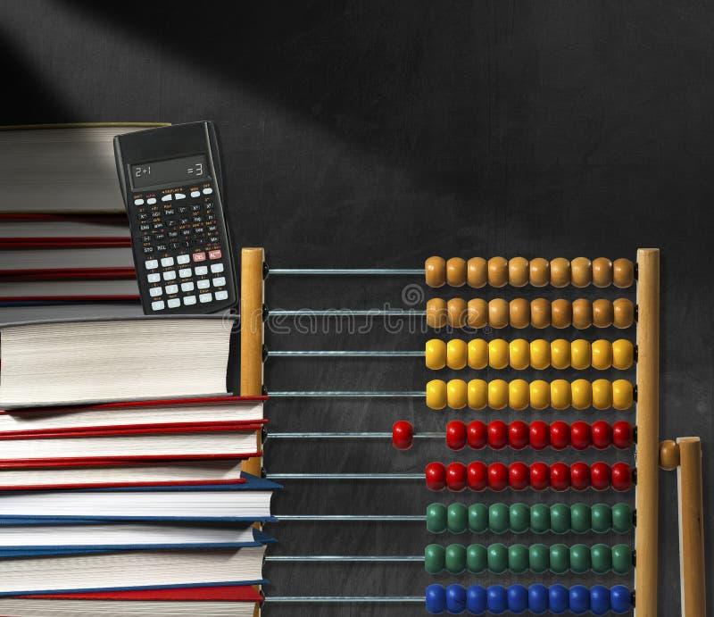 Libros y calculadora del ábaco foto de archivo libre de regalías
