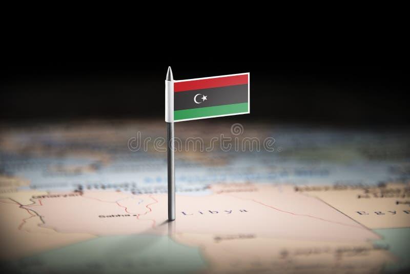 Libyen markerade med en flagga på översikten royaltyfri foto
