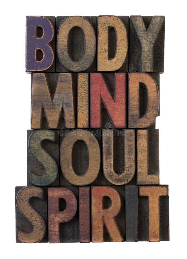 Lichaam, mening, ziel, geest in oud houten type stock foto
