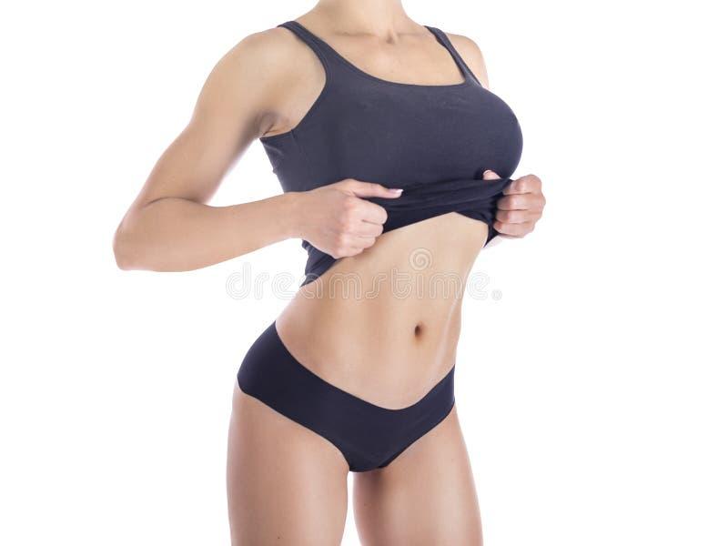 Lichaam van een mooie vrouw Mooi vrouwenlichaam Perfecte glanzende huid voor de zomer Slank gelooid vrouwen` s lichaam stock foto's