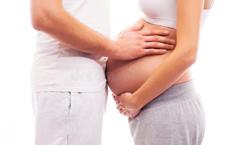 Lichaam van een zwangere vrouw en een houdende van man royalty-vrije stock foto