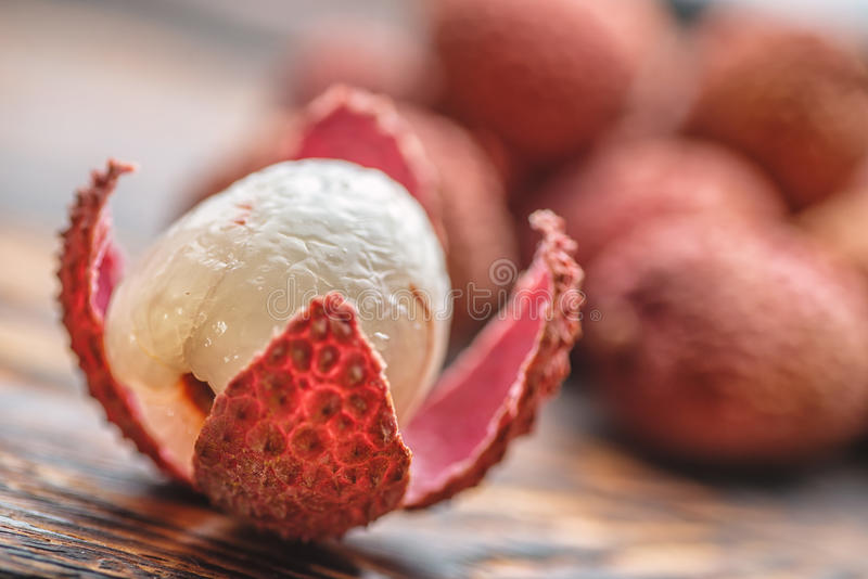 Lichee on wooden table, litchi, lychee fruit detail stock photo